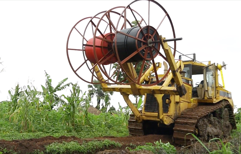 A tractor carrying telecommunication cable
